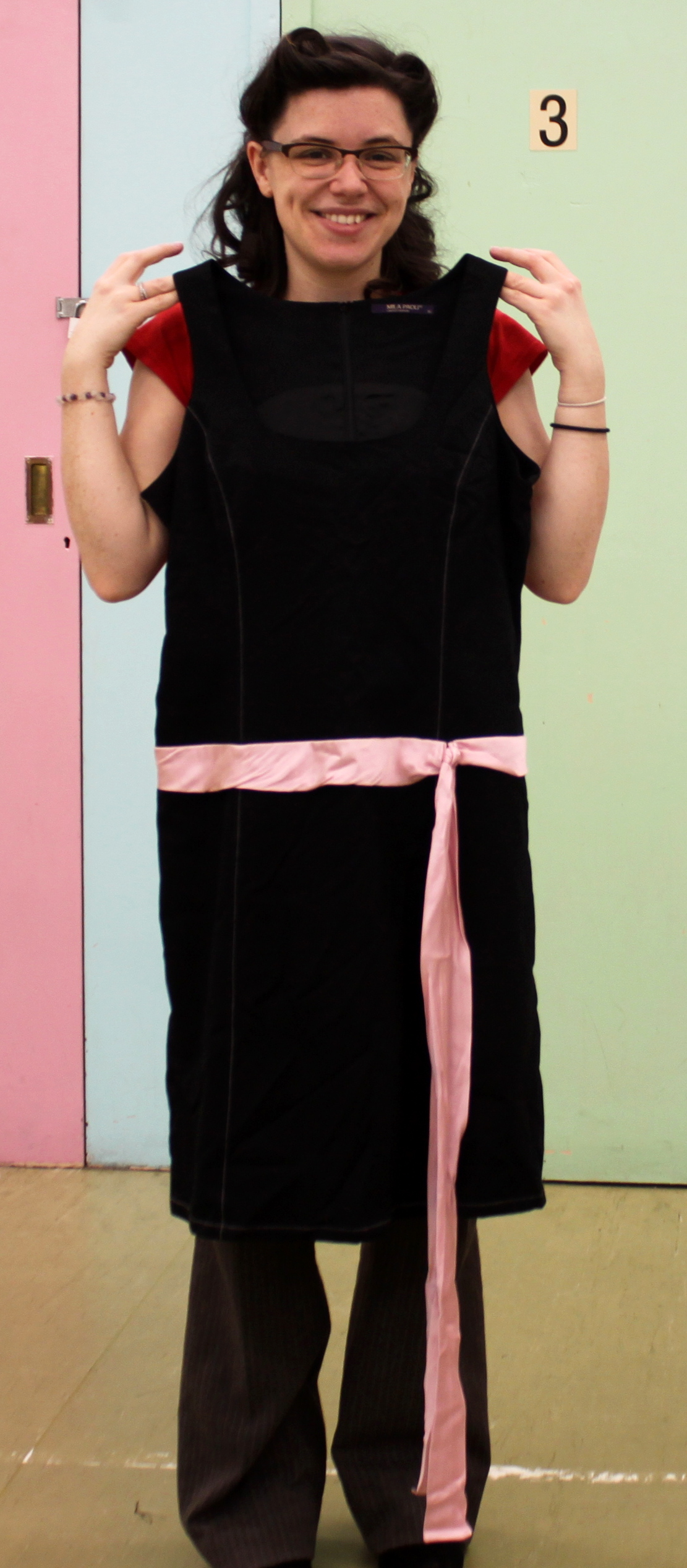 Black Sixties style shift dress with pink ribbon