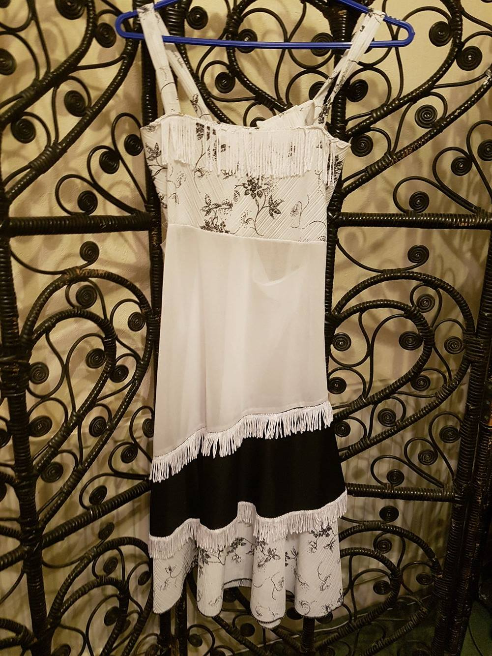 White 1920's flapper style dress with black block panel and floral patterns