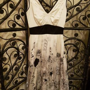 White silk dress with black floral patterns